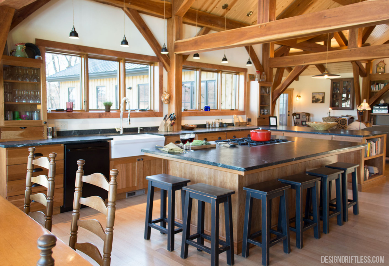 The spacious kitchen island provides a family gathering space with an incredible view