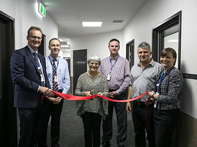 Sue Keable (pictured centre) cuts the ribbon to officially open the research centre alongside Dr Lachlan Henderson; Mr Scott Bulger; Professor Paul Fitzgerald; Sue's son Murray and Carolyn Bell.