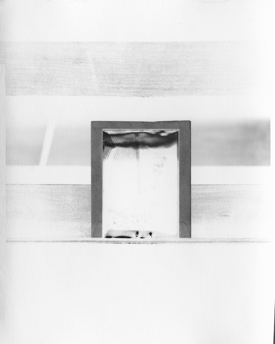 Envelope and print sleeve on stand.    Black Mountain College Papers Office of Archives and History Raleigh, North Carolina , 2011.  Silver gelatin paper negative, 5 x 4 inches.