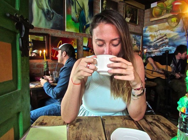 Sarah indulging in a coffee with a slice of life in Colombia