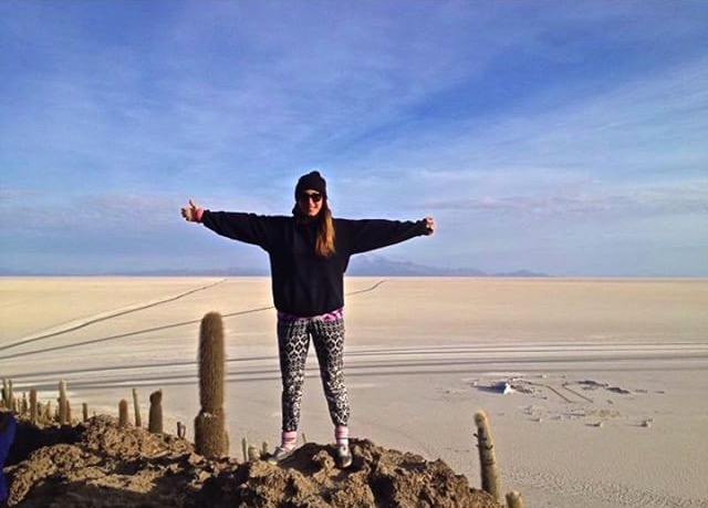 Sarah exploring the Salt Flats of Bolivia in her best backpacker chic: the enduringtucked in socks and trousers combination!