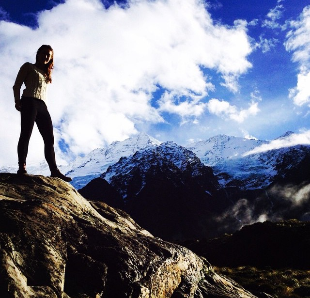 Charlotte on the Hooker Valley track, taking in the view on top of Aoraki (Mount Cook), South Island, New Zealand