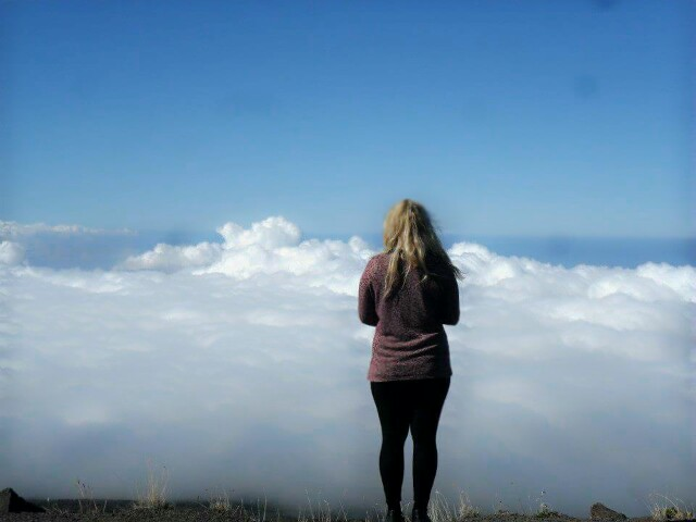 Cathy taking in the view from the top of  Haleakala, a volcano in Maui, Hawaii