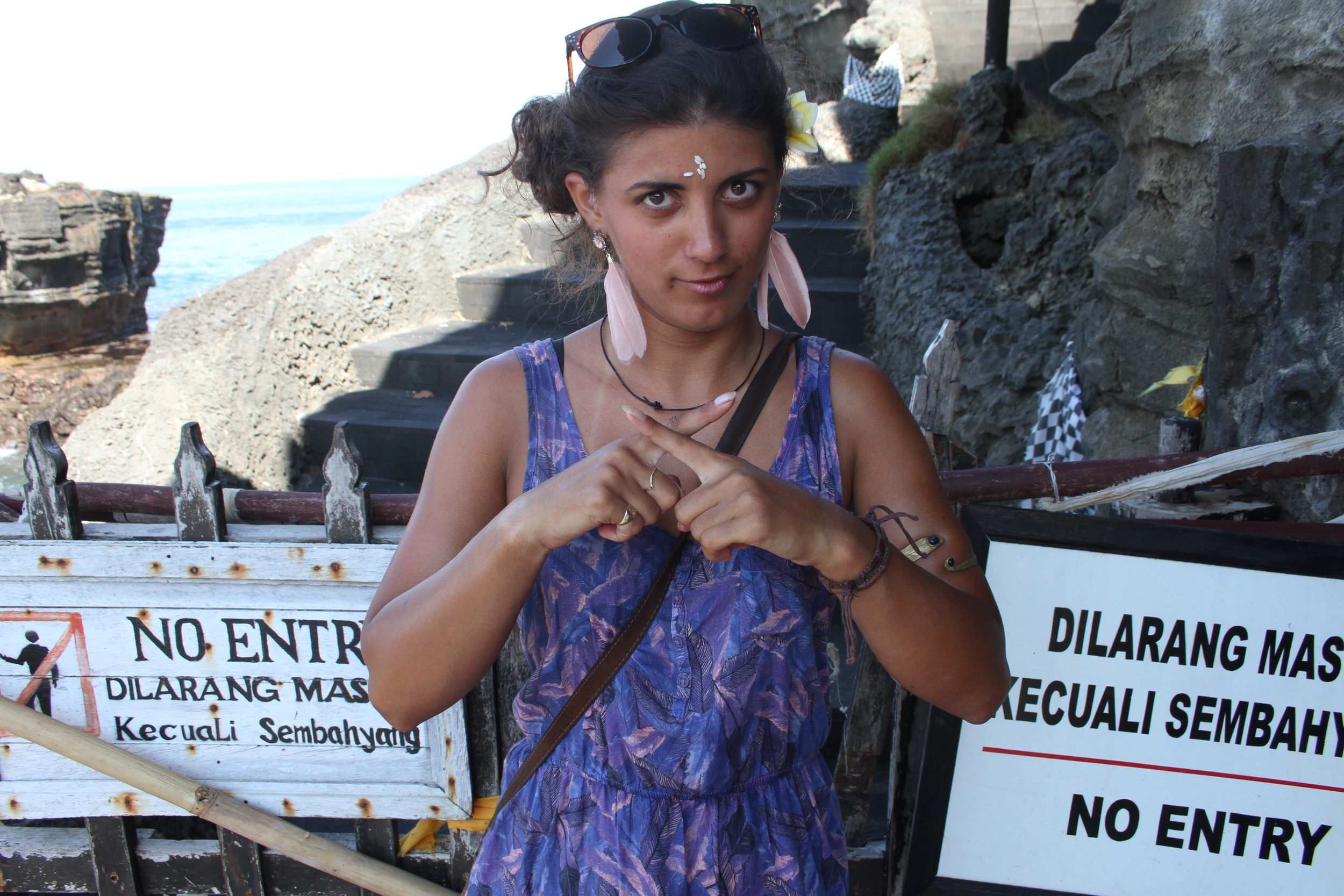 Dilara in Tanah Lot, Bali, Indonesia (the reason for the hand symbol? Dilarang = forbidden in Indonesian)