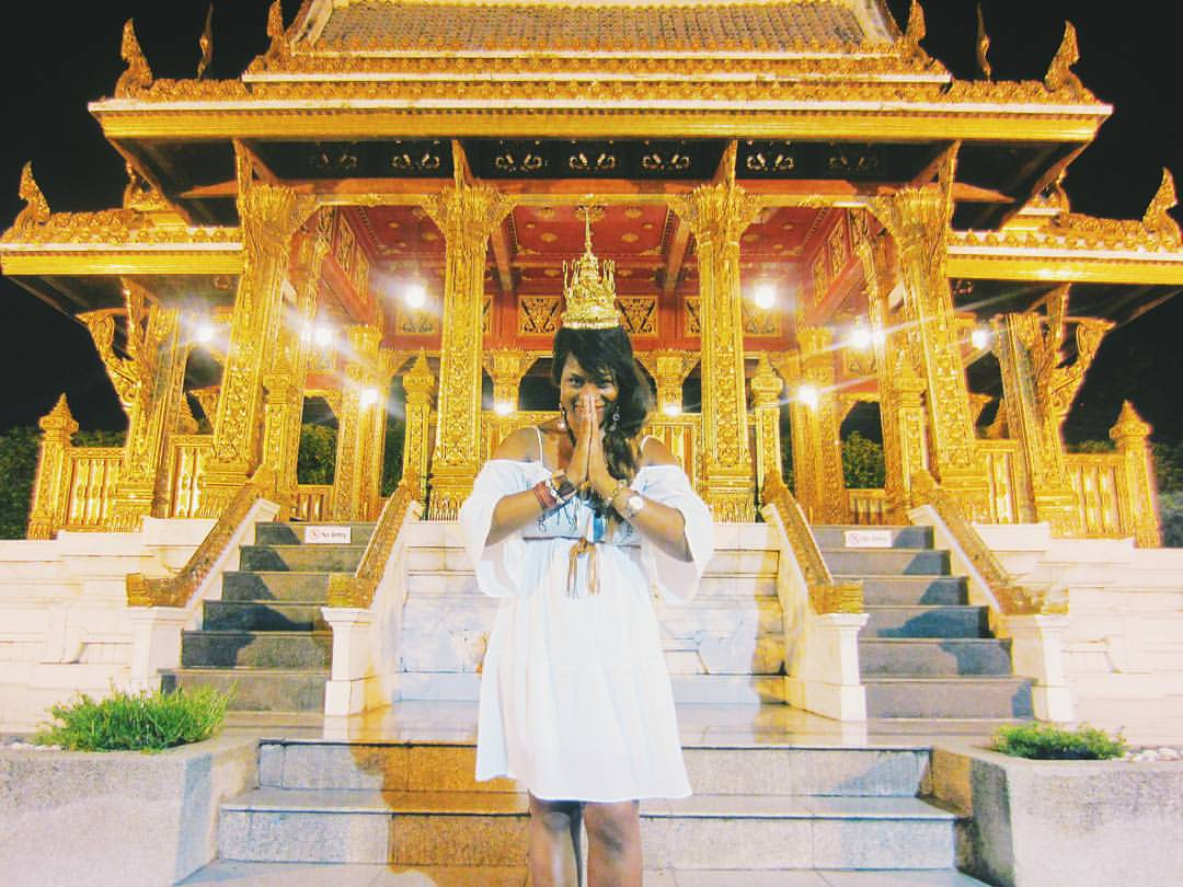Glo showing her respect outside of a local temple, Bangkok, Thailand