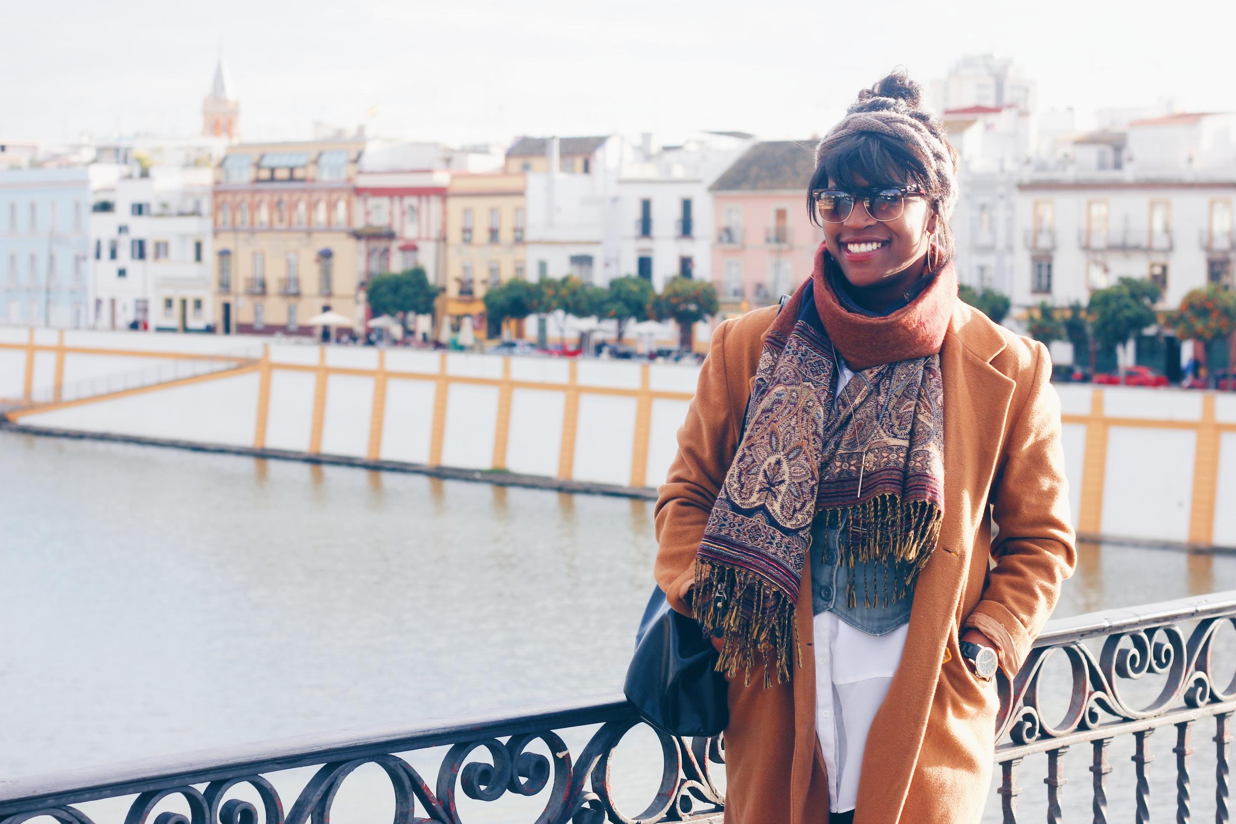 Glo taking in the riverside views of Seville, Spain