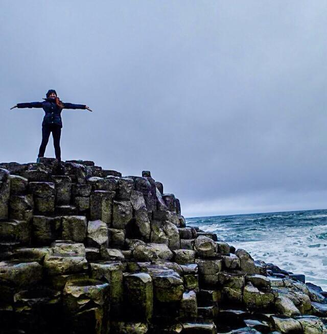Mel braving the winds at Giant's Causeway, Ireland.