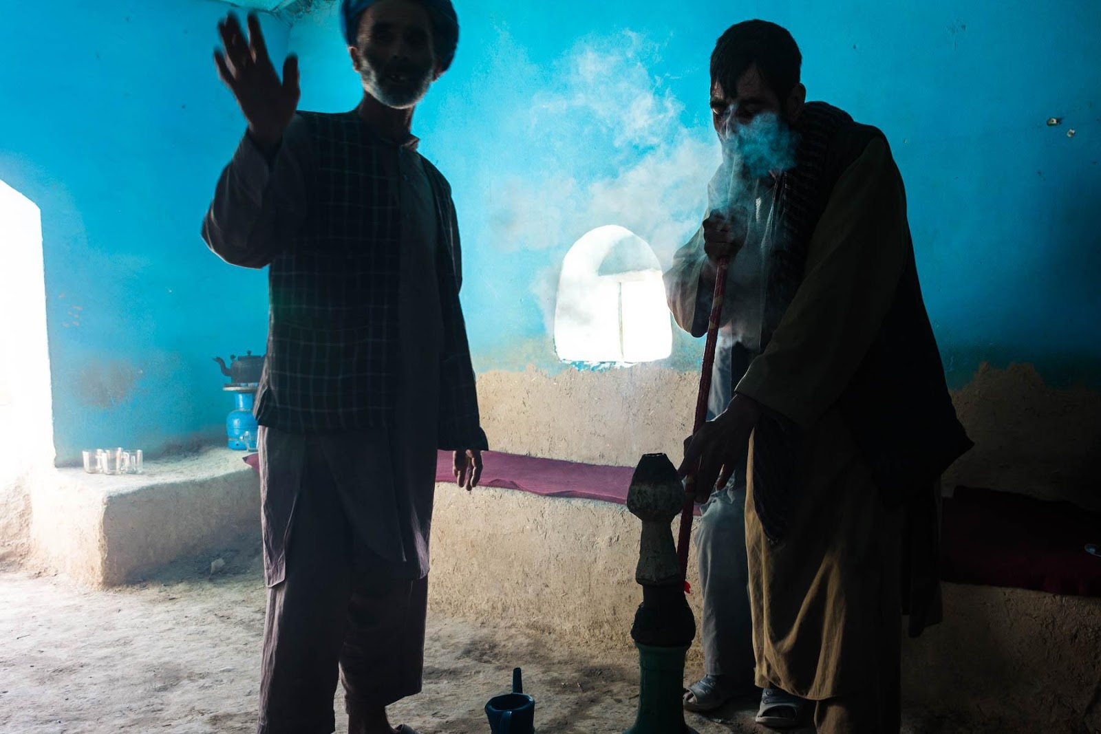 Traveling in Afghanistan is objectively difficult and unsafe, but when things work out, they're unforgettable! Case in point: heading out to the Afghan countryside to visit the ruins of an ancient city, and ending up in a shepherd's hut smoking a gigantic homemade bong (HQ: we don't condone substance abuse, nor do we condone censorship - these are Alex's words) with a bunch of local men. I couldn't dream this stuff up if I tried.