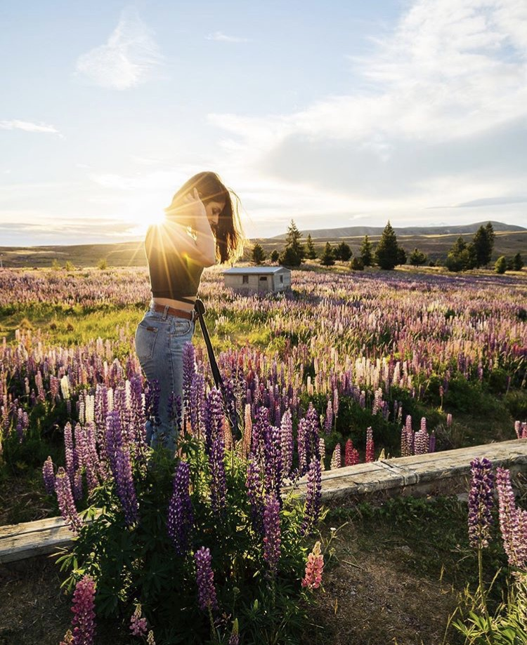 Mikaela enjoying the Lupin fields to be found surrounding Lake Tekapo, South Island, New Zealand