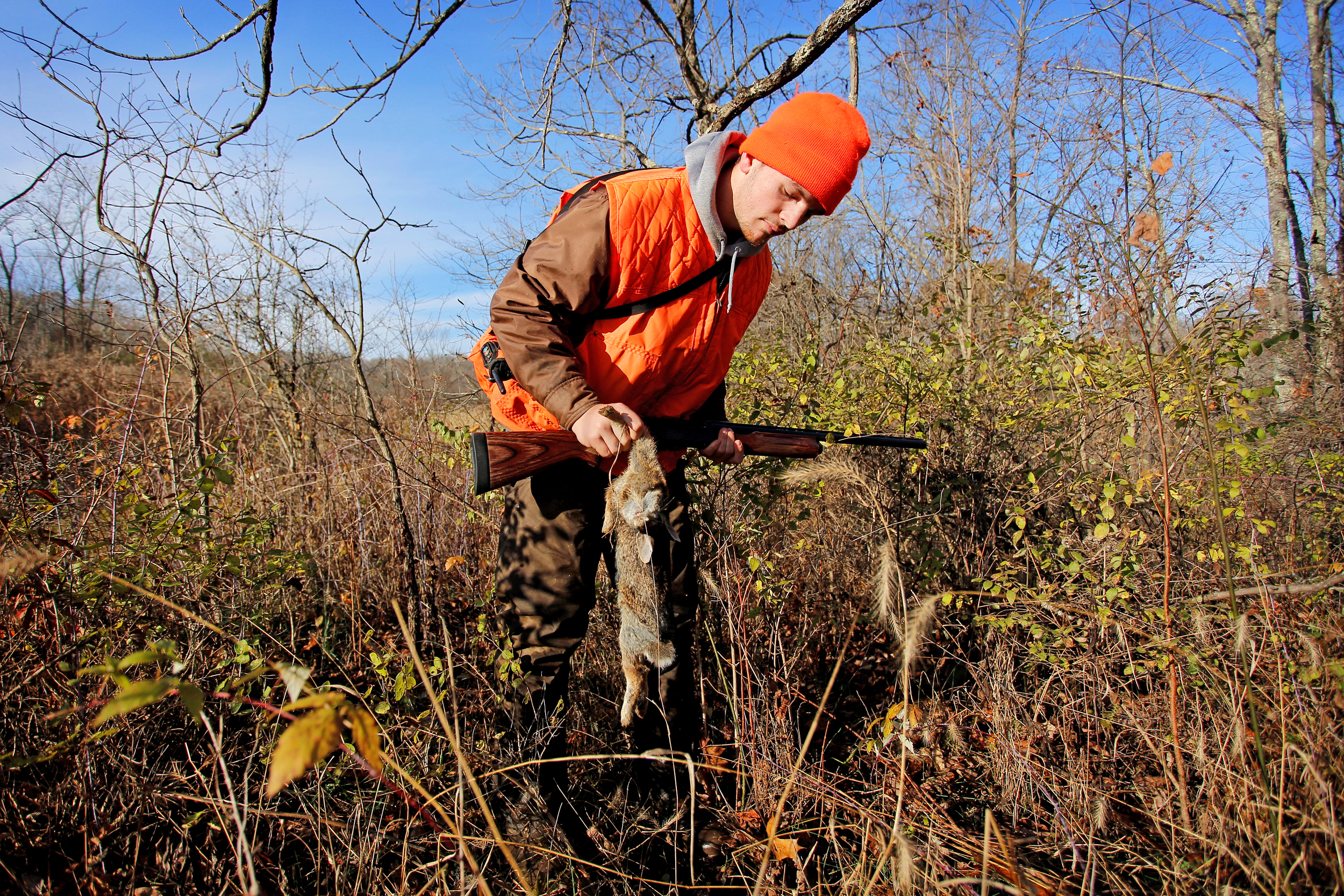 Koons examines a rabbit he shot while hunting. It was the only rabbit he shot all day.