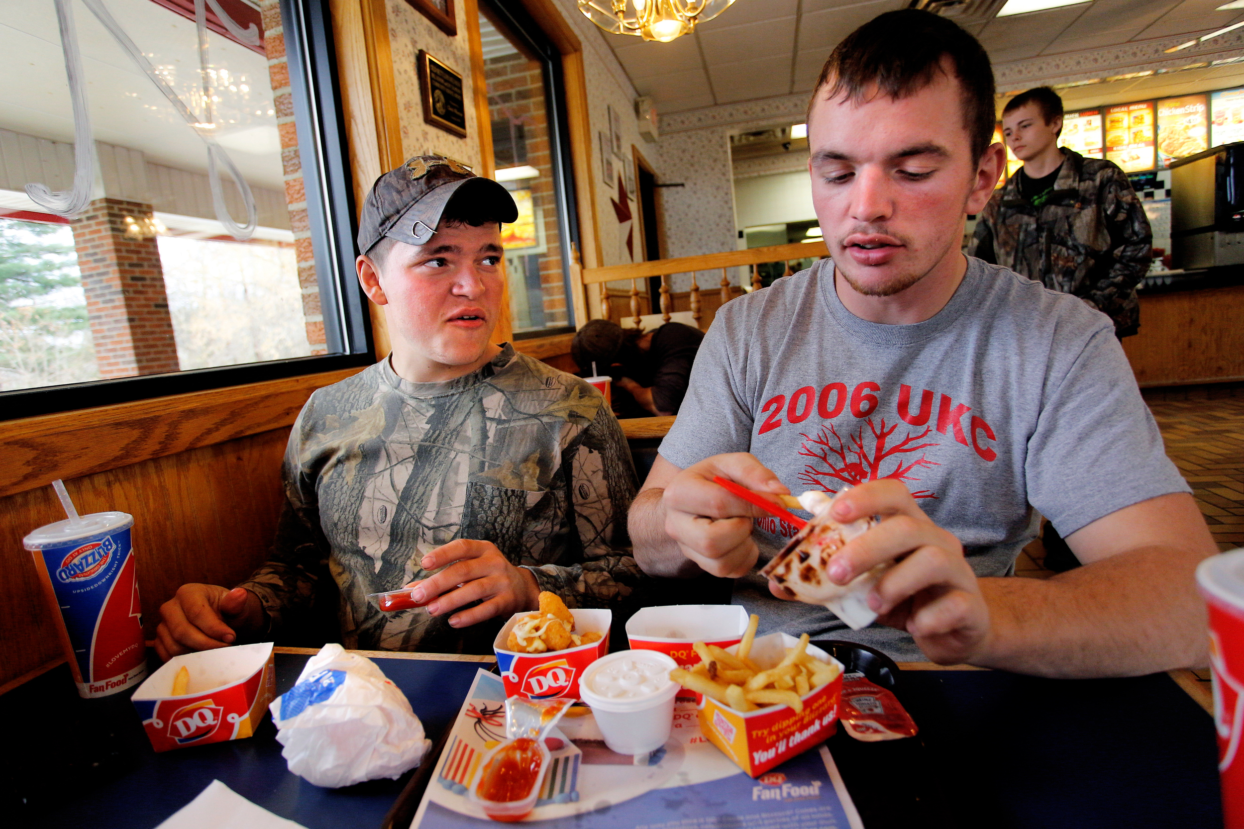Smathers chats with Jacob Koons while grabbing lunch after rabbit hunting at Dairy Queen in Glouster, Ohio.