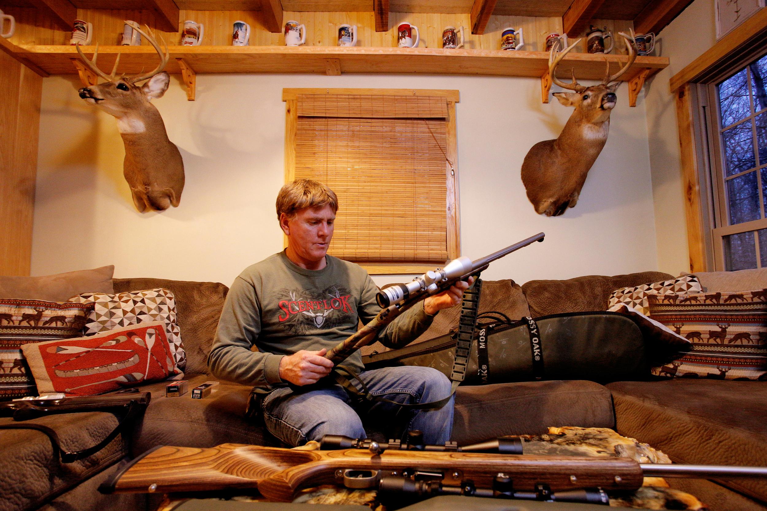 Billy Kittle examines his handmade 12-gauge Kentucky rifle at his home in Glouster, Ohio, on November 19, 2014.