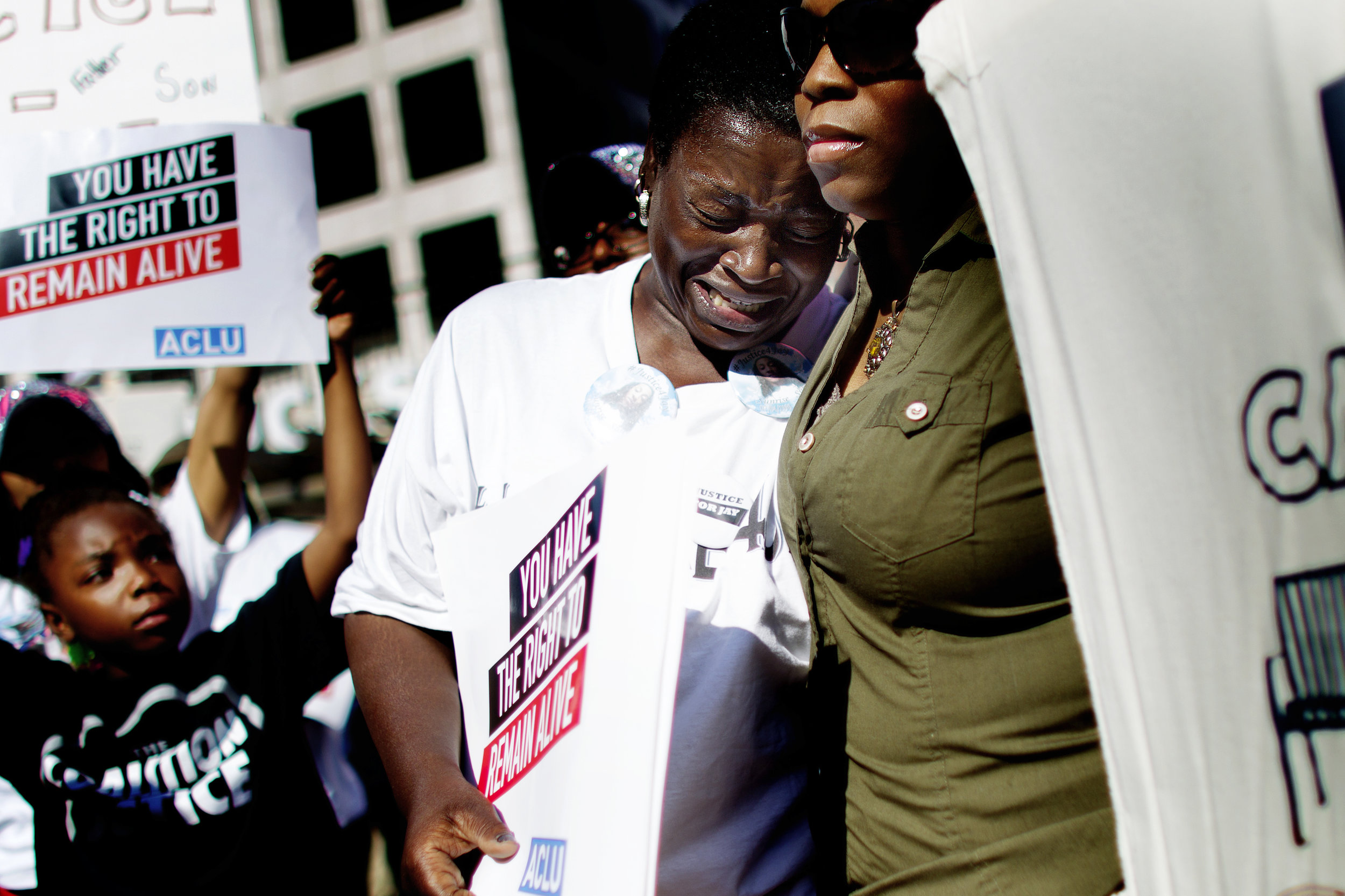 Gloria Speed, aunt of Jay Anderson, who was shot and killed by a Wauwatosa Police officer in the early morning hours of June 23rd, is comforted during a Coalition for Justice rally at Red Arrow Park in downtown Milwaukee.