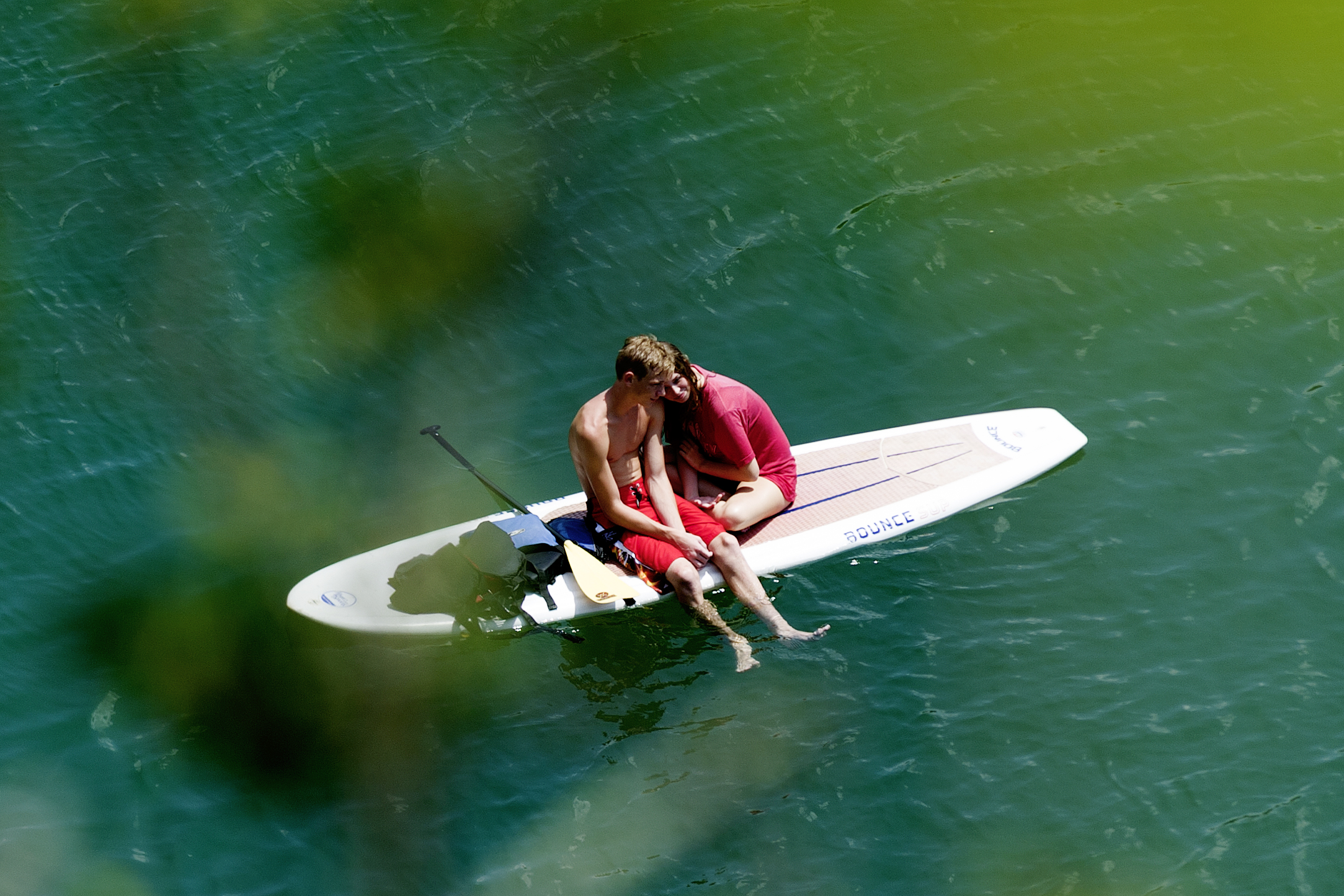 A couple enjoys an intimate moment on their paddle board at Mead's Quarry at Ijams Nature Center in Knoxville.