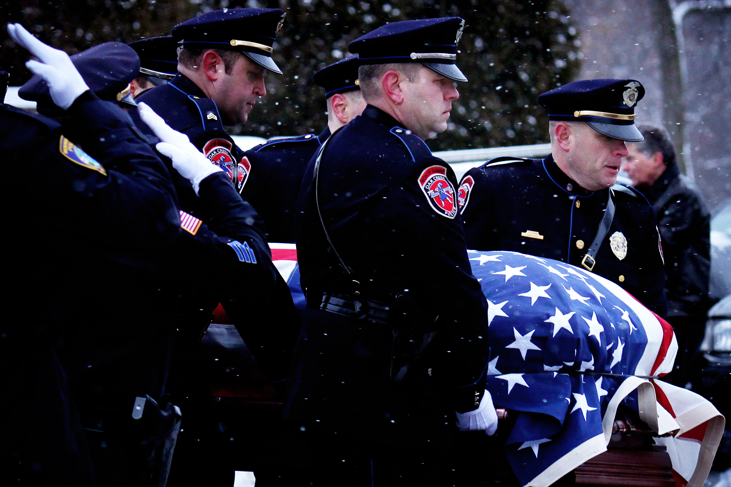 The Oak Creek Police Department Honor Guard carries the casket of Jennifer Sebena to her final resting place at Wisconsin Memorial Park in Brookfield, Wisconsin, on December 29, 2012. Wauwatosa Police Officer Jennifer Sebena was shot and killed by her husband, Benjamin Sebena, while on duty Christmas Eve.
