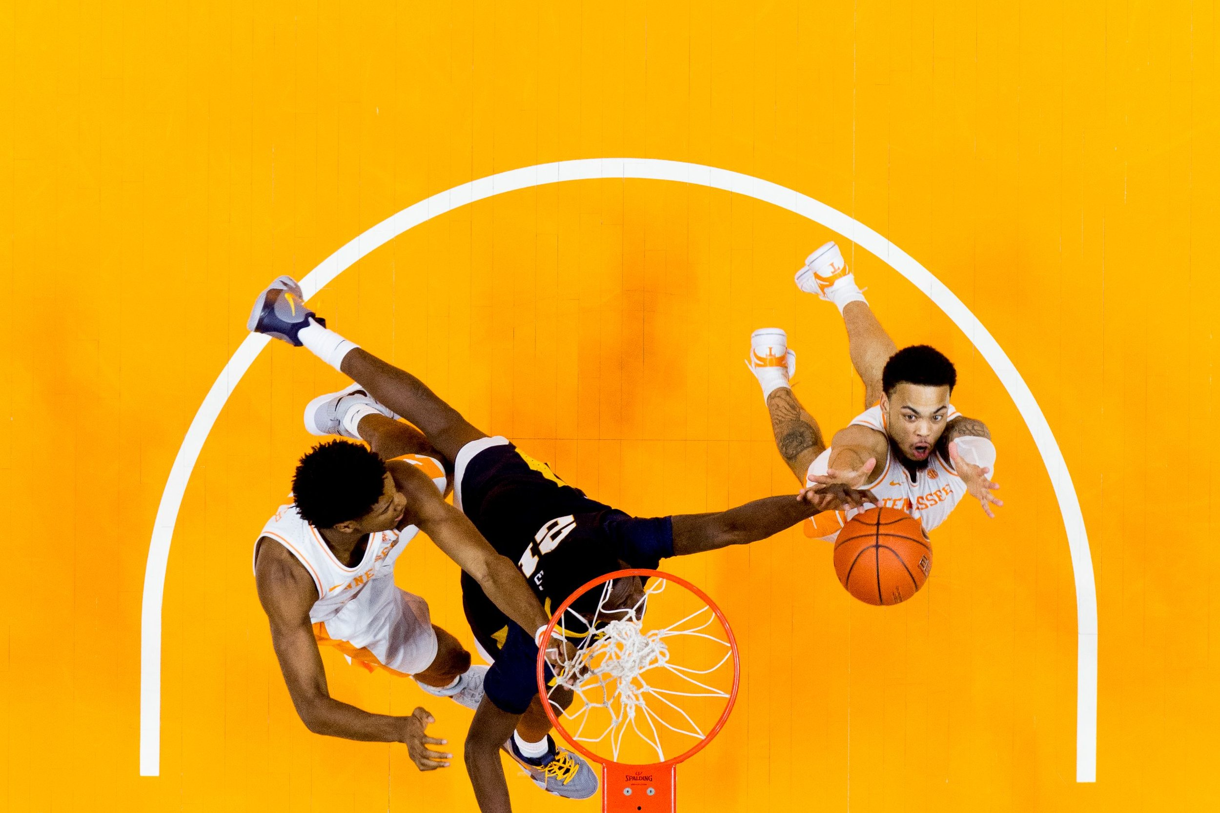 Tennessee guard Jordan Bone (0) grabs the rebound from West Virginia forward Wesley Harris (21) during a SEC/Big 12 Challenge game between Tennessee and West Virginia at Thompson-Boling Arena in Knoxville.