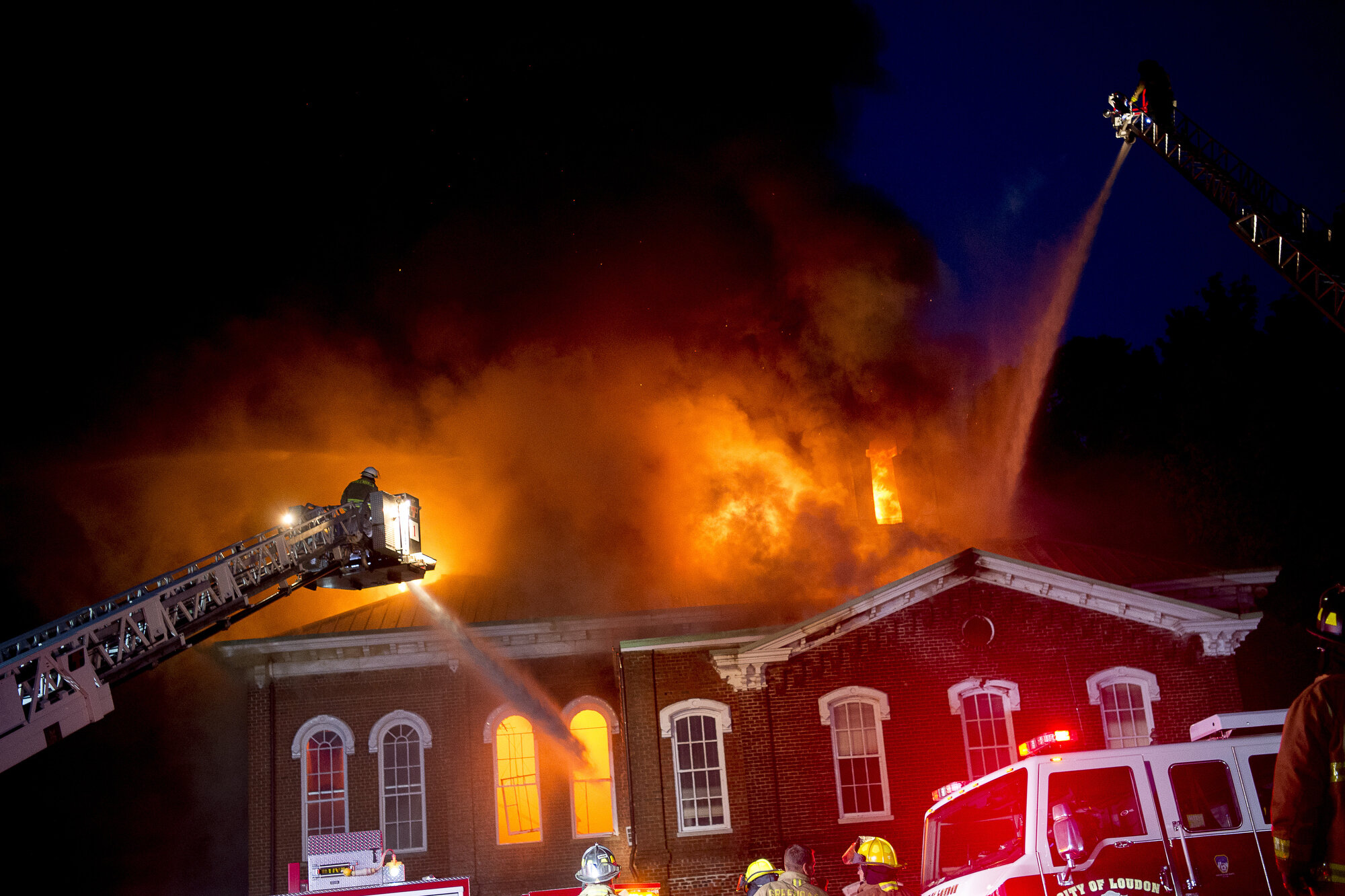 Firefighters douse the flames with water from ladder trucks at a fire at the Loudon County Courthouse in Loudon, Tennessee on Tuesday, April 23, 2019. The building, which was built in the 1870's and listed on the National Register of Historic Places, was consumed almost entirely by flames Tuesday evening.