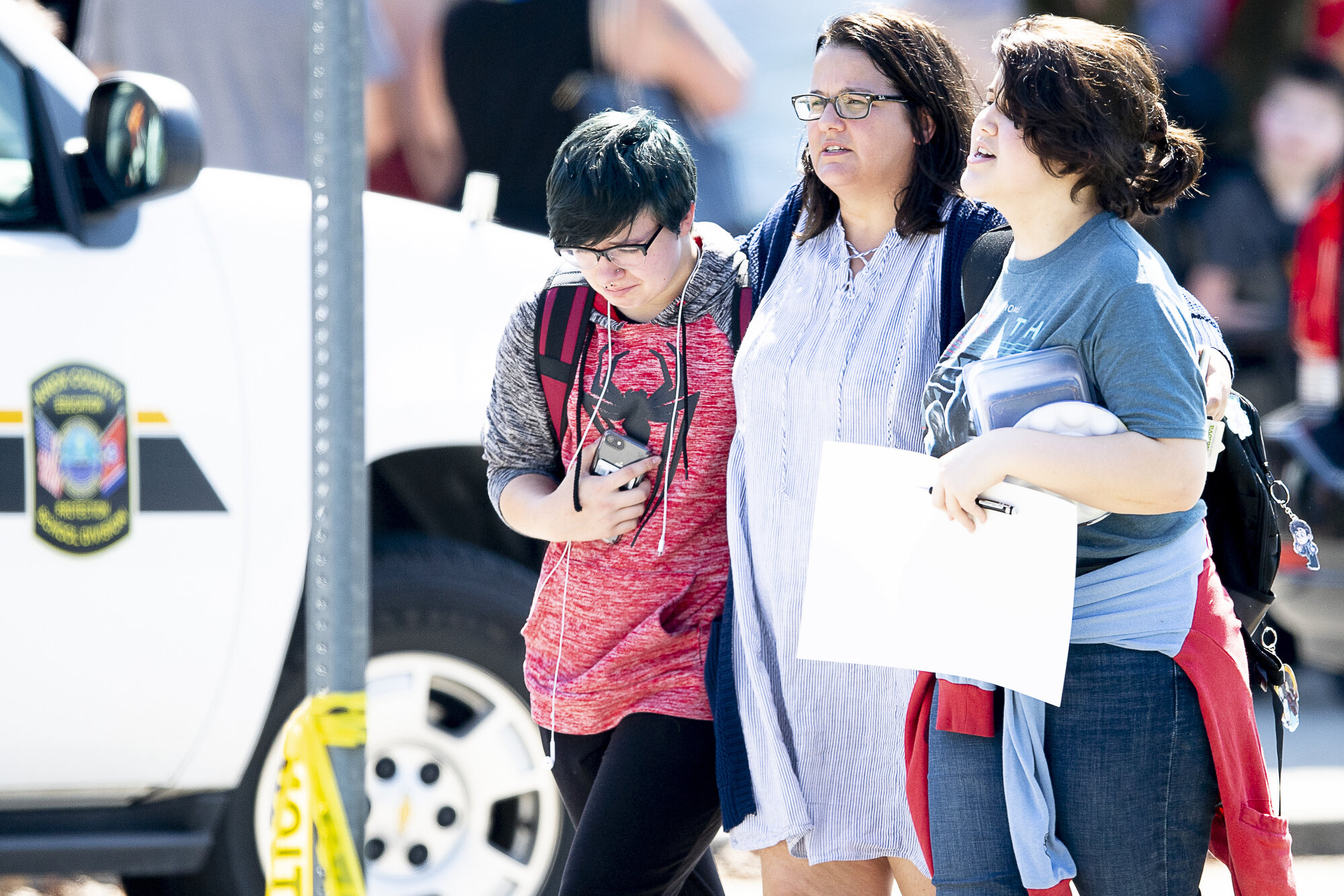 Student walk out of school with a loved one at Powell High School after unconfirmed reports of shots fired outside the school in Powell, Tennessee on Tuesday, September 3, 2019.