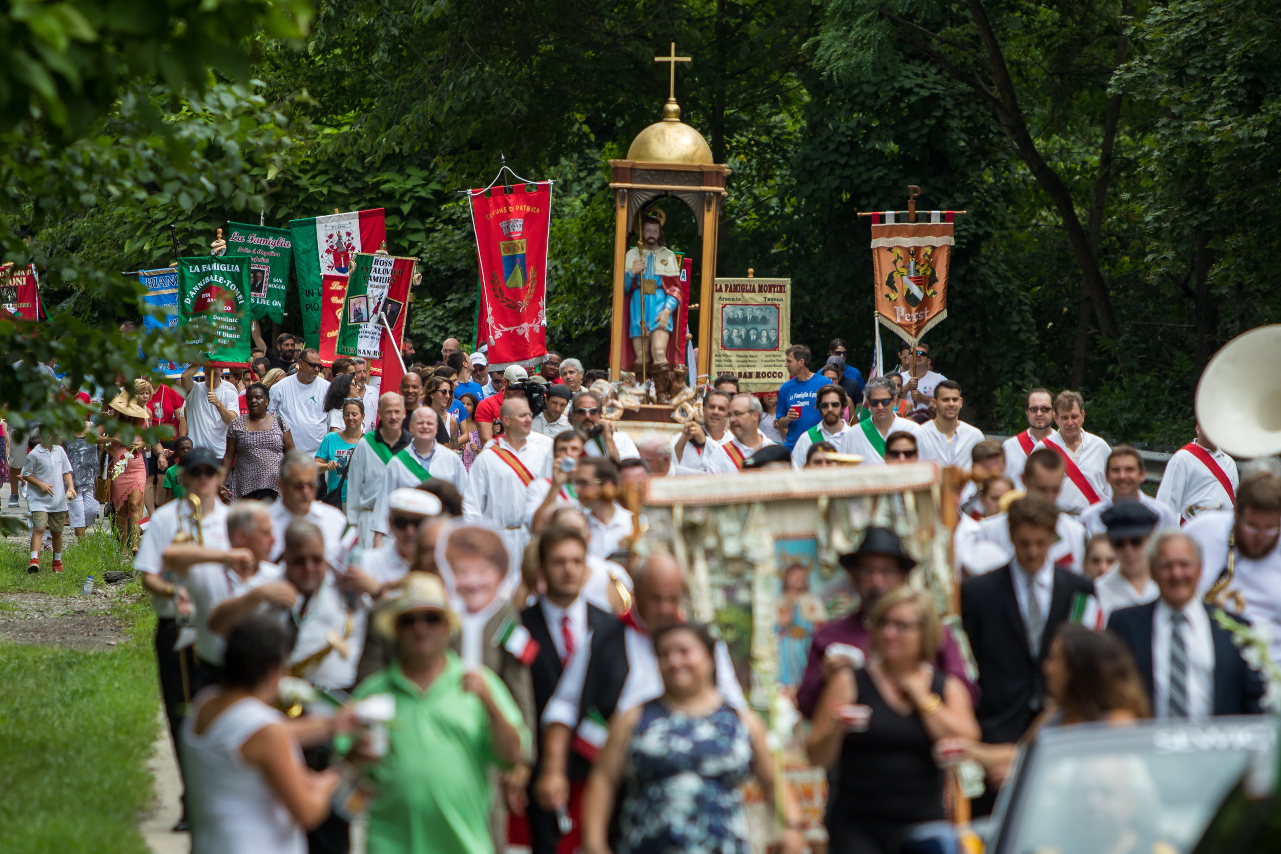 Thousands of people participated in the procession after the San Rocco Liturgy at St. Titus Church in Aliquippa on Sunday morning. The procession featured many families with family banners marching through the streets of Aliquippa with the San Rocco Festa Band and the statue of San Rocco.