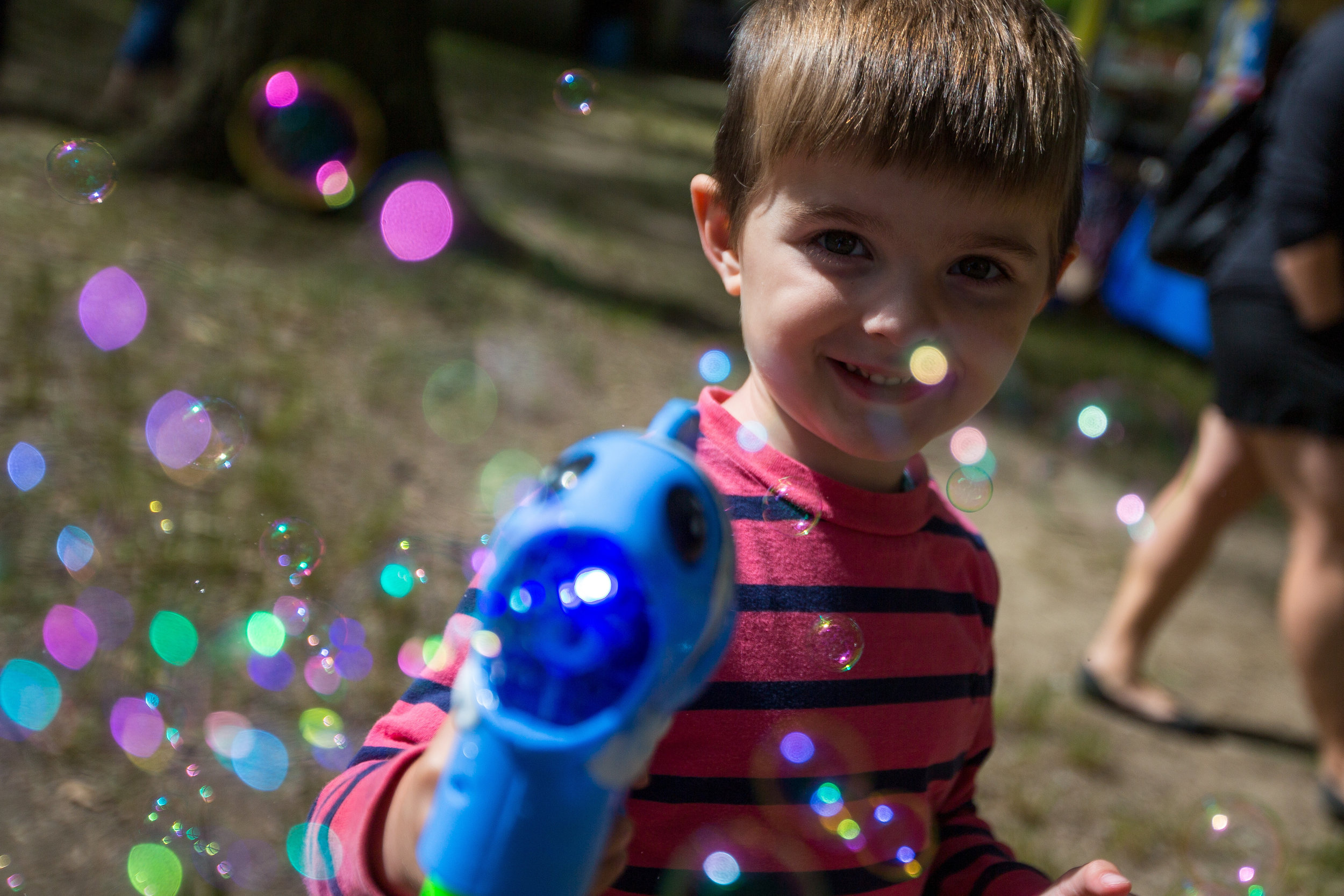 Benson Puff, 3, plays with a bubble machine at the Ellwood City Arts Festival at Ewing Park on Saturday morning.