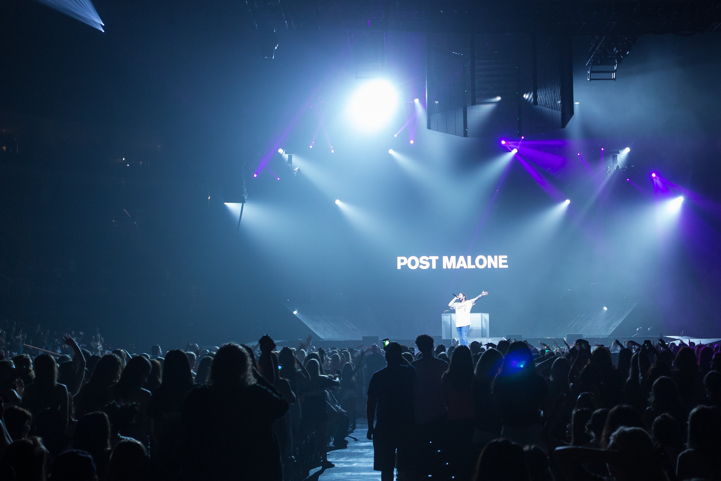 Post Malone performs on stage while opening for Justin Beiber at the Consol Energy Center on Wednesday evening.