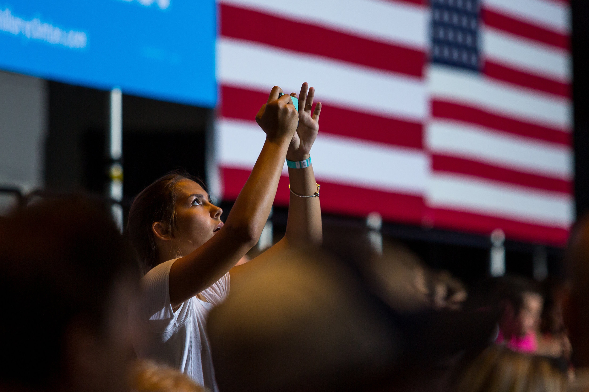 A girls takes a photo on her phone before the beginning of the Hillary Clinton and Tim Kaine rally at the David L. Lawrence Convention Center on Saturday evening. Clinton has clenched the democratic nomination and is the first major party female nomination in US history.