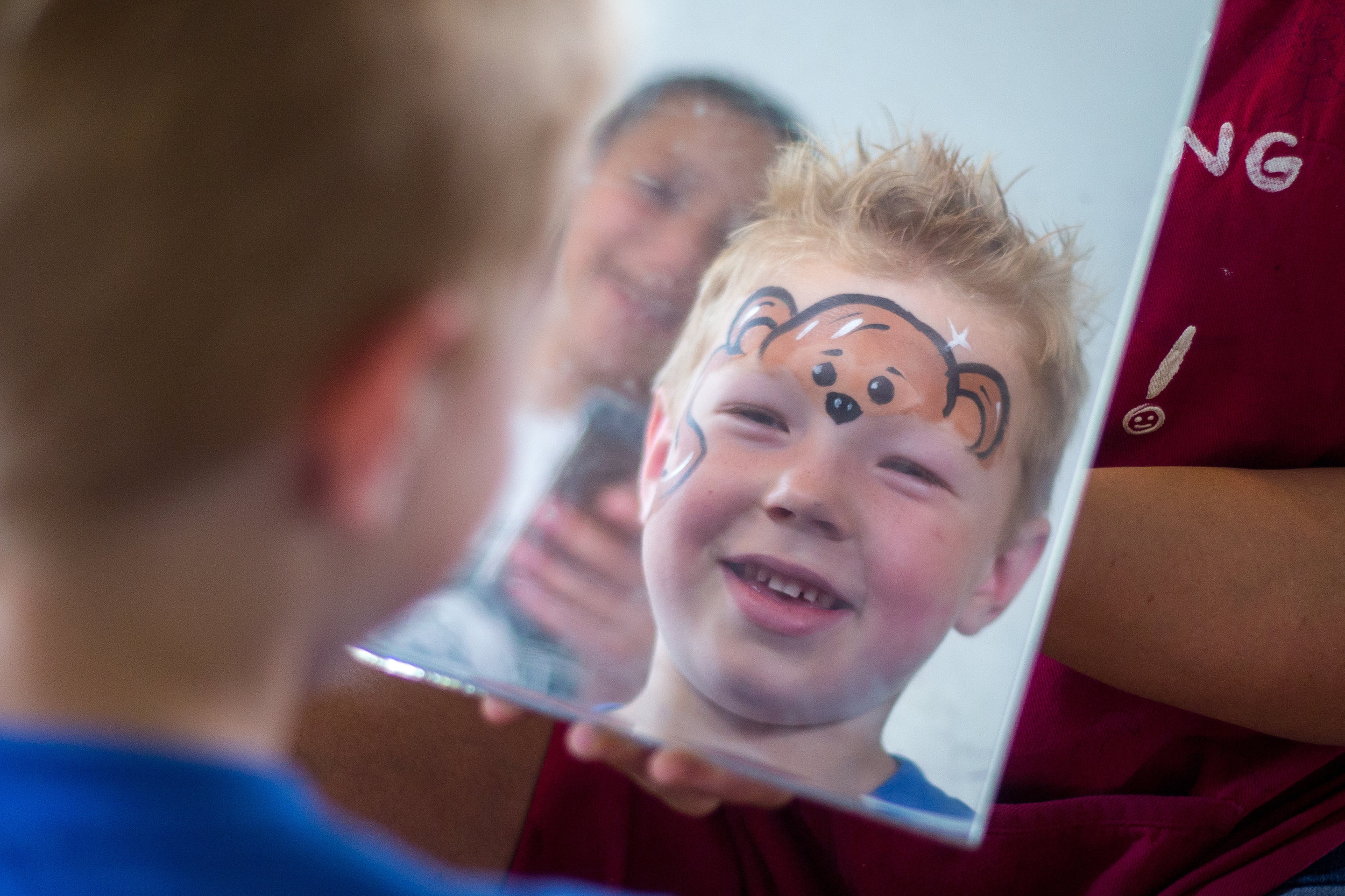 Jesse Shaffer, 7, of Darlington, smiles as he sees his face painted like a monkey by Teressa Hajtol at the Beaver County Bookfest in Beaver on Saturday afternoon. The Bookfest featured over 50 authors, a children's tent, food vendors and activities.