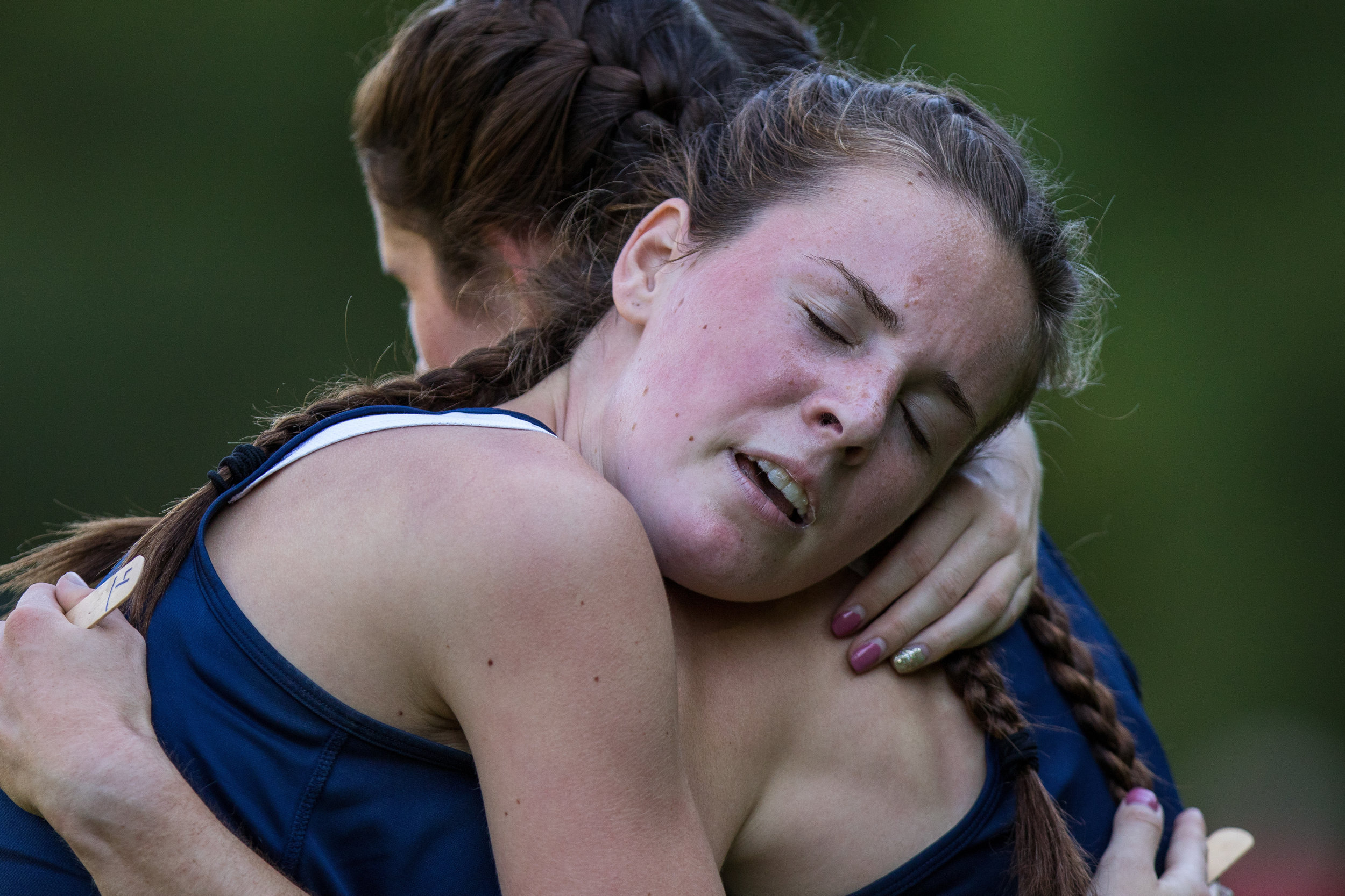 Lauren McCoy, right and Carinna Lapson both of Hopewell High School embrace after they both crossed the finish line of the women cross county meet at Hopewell Community Park on Tuesday afternoon. McCoy and Lapson won third and fourth place, with times of 21:17 and 21:31 respectively.