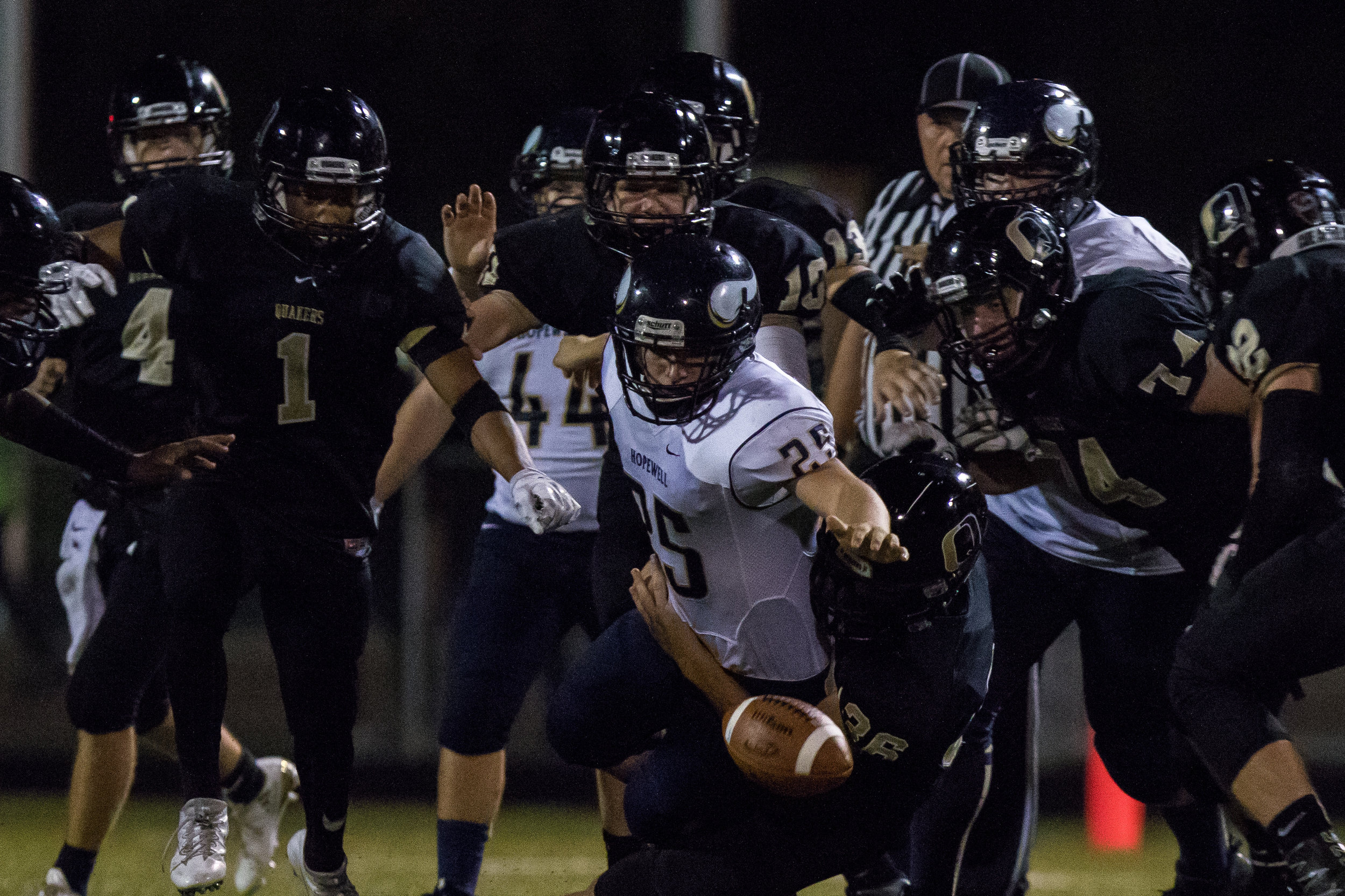 Hopewell's Daniel Wes Smith, 25 and Quaker Valley defenders all reach for a fumble caused by Quaker Valley during the second half of play at Quaker Valley on Friday evening. Quaker Valley beat Hopewell at home 31-14.
