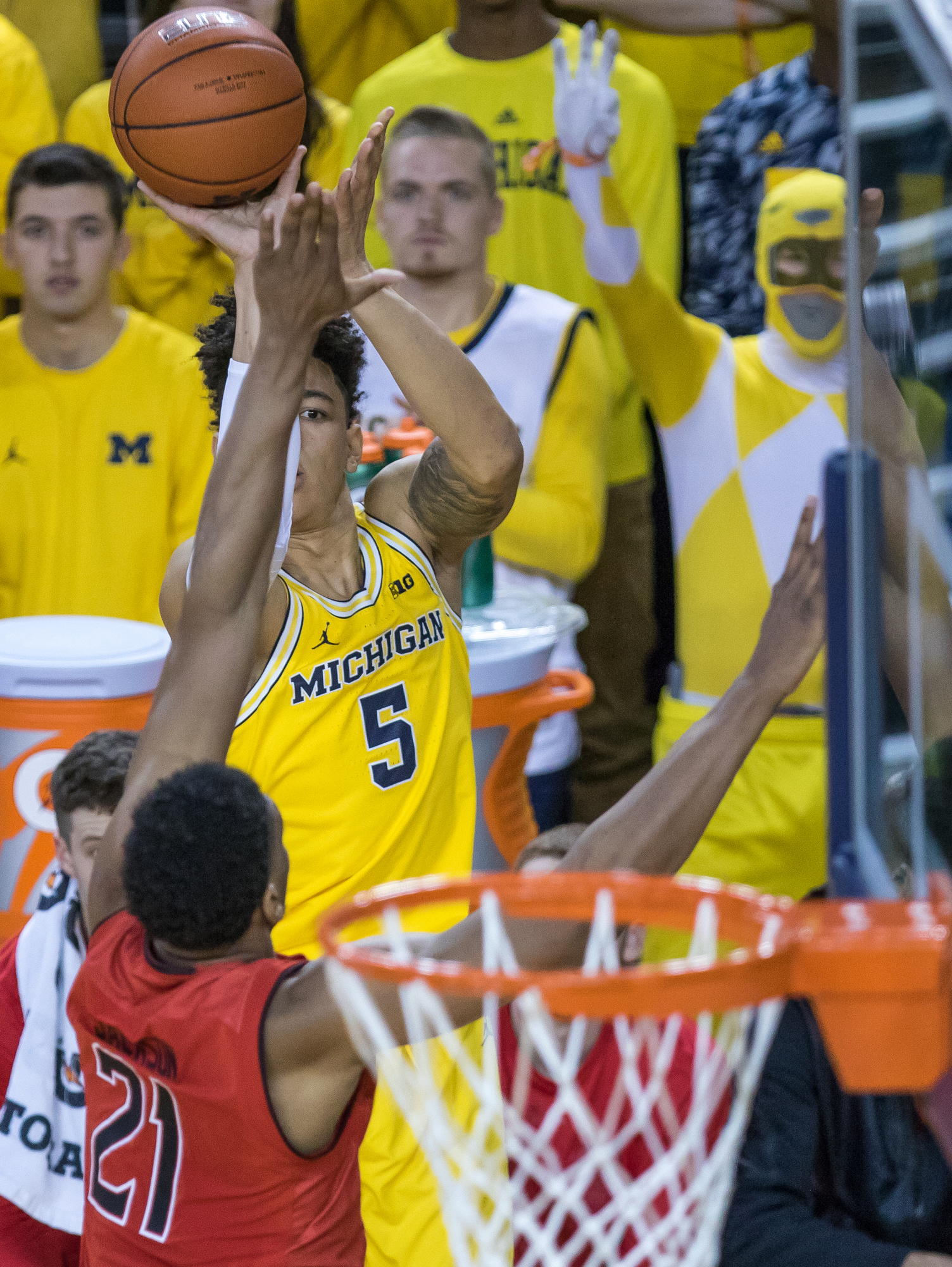 Michigan�s D.J. Wilson (5) shoots a three-point-shot during the first half of play against Maryland at the Crisler Center on Saturday, January 7, 2017. The Michigan Wolverines lost to the Maryland Terrapins 70-77. Matt Weigand | The Ann Arbor News