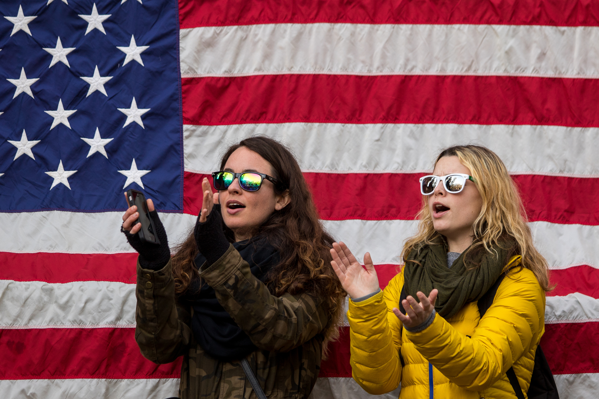 Mecca McNulty, left and Audrey Torma cheer at the Diag at the University of Michigan during the Women's March on Saturday, January 21, 2017.  The march was one of several throughout the country and drew over 6,000 people. Matt Weigand | The Ann Arbor News