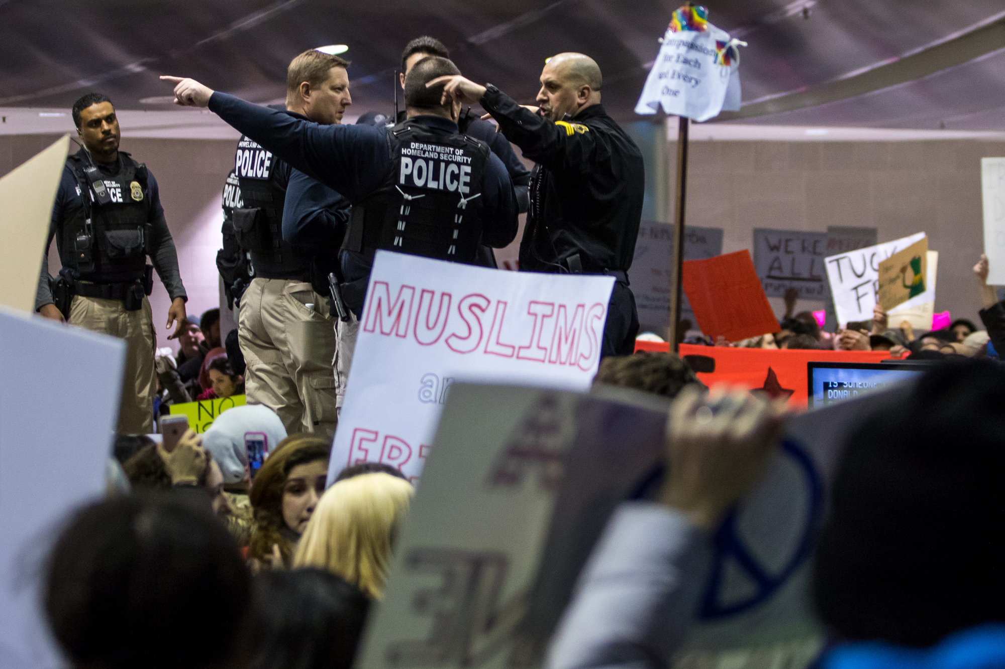 Police stand guard as thousands packed into the baggage claim at Detroit International Airport to protest President Trump and his immigration policy on Sunday, January 29, 2017. Matt Weigand | The Ann Arbor NewsMatt Weigand | The Ann Arbor News