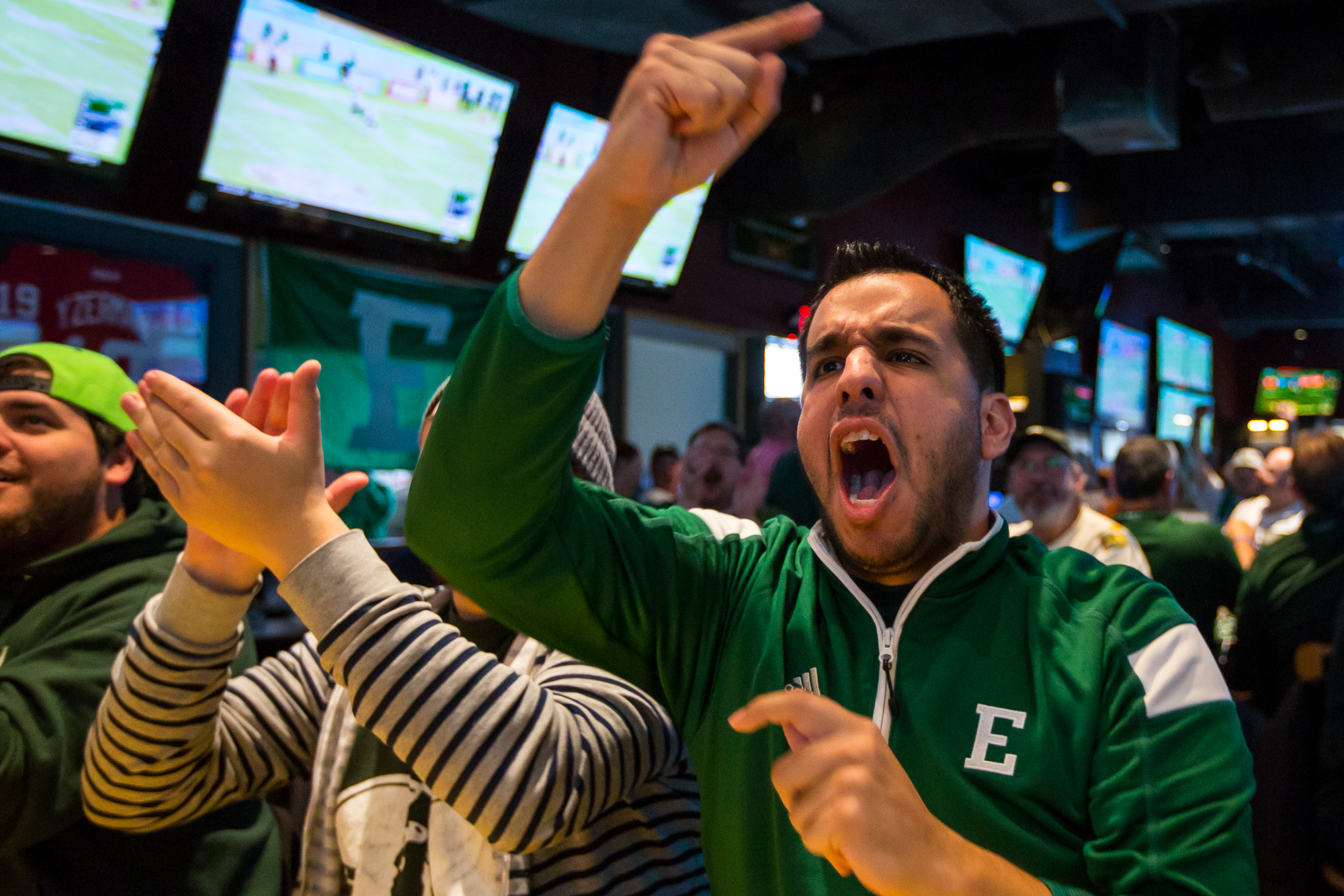 Frank Anderson screams as Eastern Michigan University plays Old Dominion during the Bahamas Bowl from Buffalo Wild Wings in Ypsilanti on Friday, December 23, 2016. EMU has not been to a bowl game since 1987 when they played in the California Bowl. Matt Weigand | The Ann Arbor News