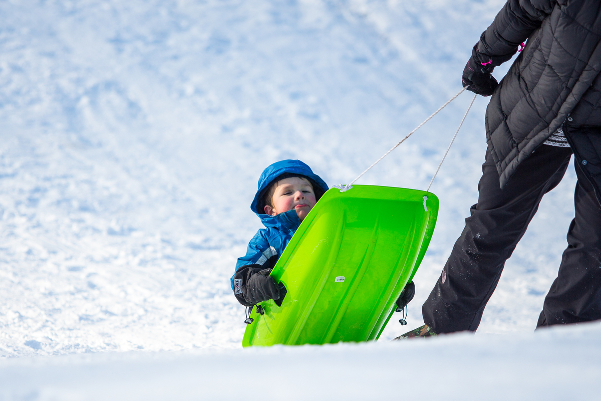 Jude Anderson, 4, is pulled up a hill at Burt Park by his mom Jessica on Thursday, February 2, 2017. Matt Weigand   The Ann Arbor News