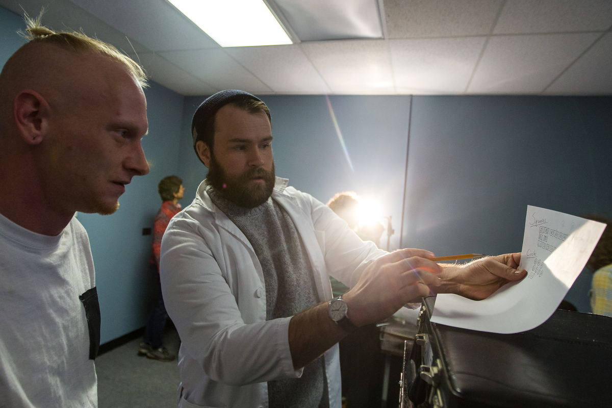 James Kelly, center, talks with Zachary Irwin while attempting to solve a puzzle while in an escape room at Decode Detroit on Sunday, February 5, 2017. The escape room has been voted as one of the top escape rooms by Yelp, Trip Advisor and Facebook. Matt Weigand   The Ann Arbor News