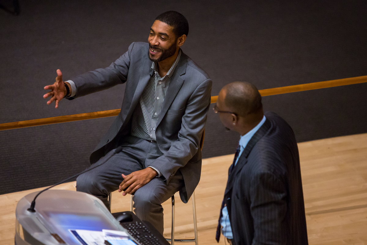 Jimmy King, member of the Fab 5, left, speaks with Ray Jackson Jr. during the 3rd Annual William Monroe Trotter Lecture in the Robertson Auditorium on Thursday, February 9, 2017. The lecture highlighted the black male athlete and invited three speakers to give their thoughts on the subject. Matt Weigand | The Ann Arbor News
