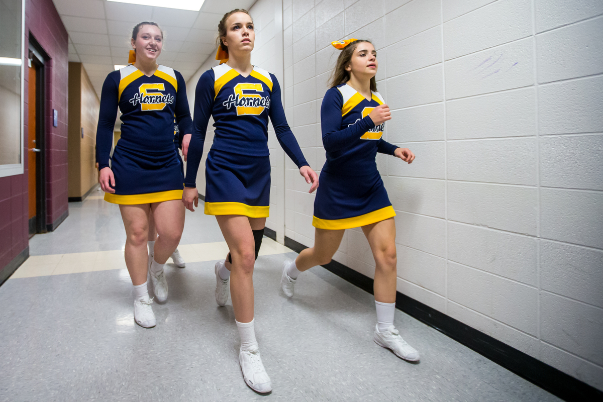 Ellie Peterson, Saline High School sophomore, center, walks with teammates after the second round of the 2017 Dexter Competitive Cheer Invitational at Dexter High School on Saturday, February 11, 2017. The Saline team got first place with an overall score of 663. Matt Weigand | The Ann Arbor News