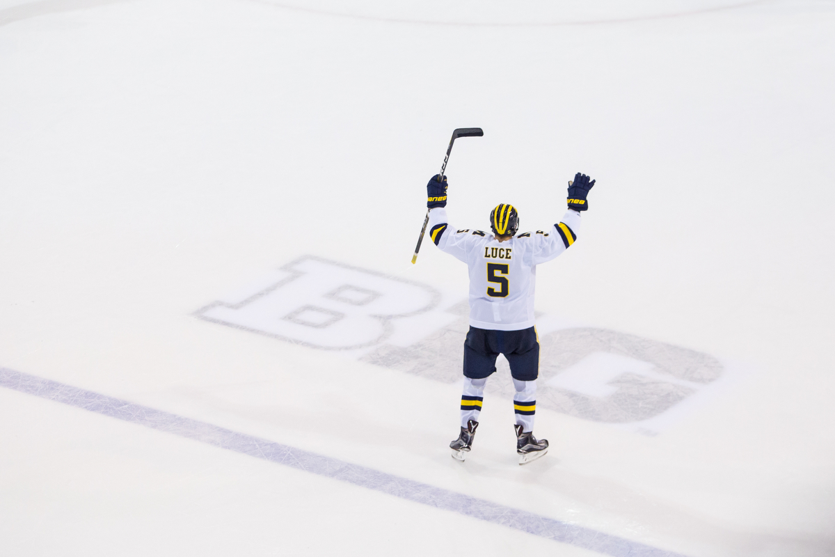 Michigan's Griffin Luce (5) celebrates after scoring Michigan's only goal during the last seconds of the matchup against Michigan State at Yost Ice Arena on Saturday, February 11, 2017. The Michigan State Spartans beat the University of Michigan Wolverines 4-1. Matt Weigand | The Ann Arbor News