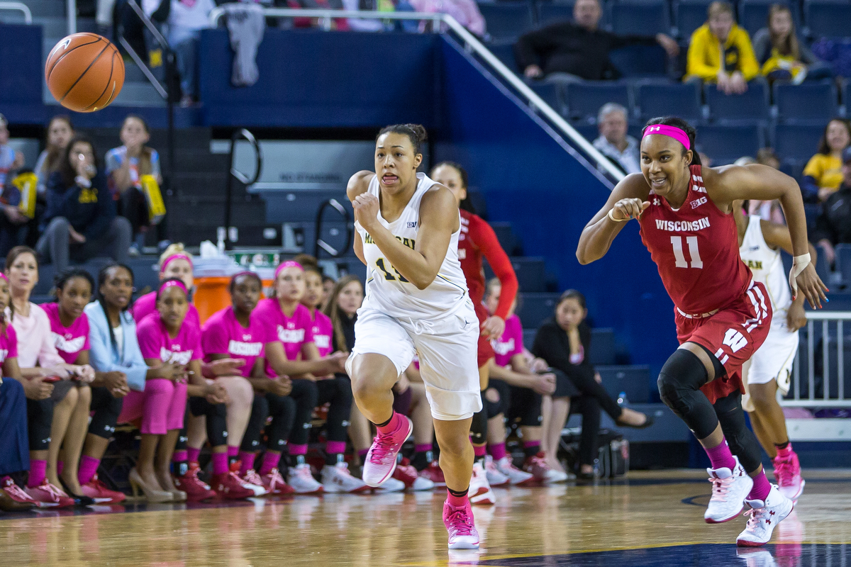 Michigan's Jillian Dunston (11), left and Wisconsin's Marsha Howard (11) run after a loose ball during the second half of play at the Crisler Center on Sunday, February 12, 2017. The Michigan Wolverines beat the Wisconsin Badgers 75-66. Matt Weigand | The Ann Arbor News