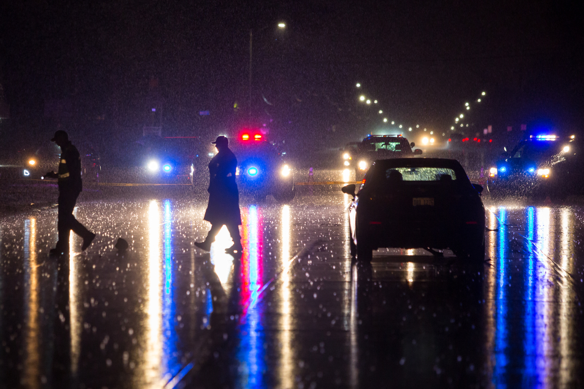 Police talk near a car in the middle of East Michigan Ave. near Wiard Road after a car verses pedestrian accident, leaving one fatality, occurred in Ypsilanti on the evening of Friday, February 24, 2017. The incident is still under investigation. Matt Weigand | The Ann Arbor News