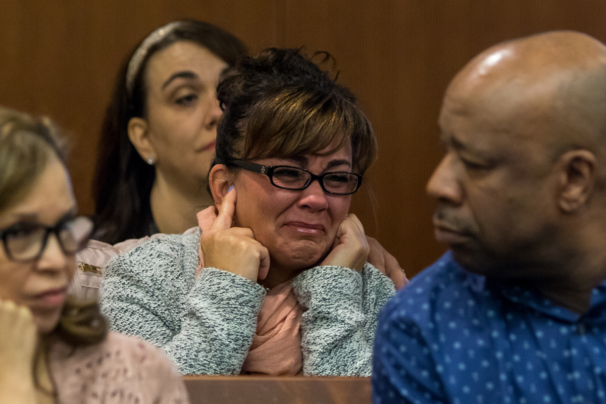 People sitting in court room three react during Michigan State Trooper Patrick Gallagher's testimony during a preliminary examination in the court case for Marcus Palmer at the 15th District Court on Friday, March 24, 2017. Palmer is accused of murdering 18-year-old Zachary Curry on the morning of July 24, 2016. Matt Weigand | The Ann Arbor News
