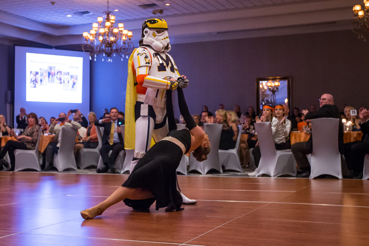 Jon Leopold, also known as the Wolverines Trooper, dances with Greta VanDoren during the dance competition during the Dancing with the Michigan Stars event at the Kensington Hotel on Thursday, March 30, 2017. All benefits of the competition proceed the ChadTough foundation, which benefits a pediatric form of brain cancer. Matt Weigand | The Ann Arbor News