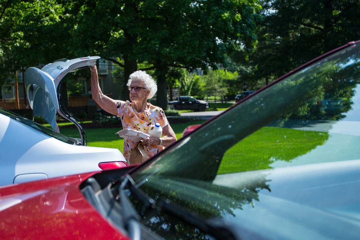 Hazel Cottage carries food to a resident for Meals on Wheels in Sewickey on Monday June 20, 2016. Cottage won the Unsung Hero Award for her 19 years of work with the the organization.