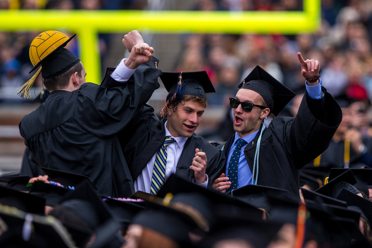 A group of graduates celebrate  during the 2017 University of Michigan spring commencement at Michigan Stadium on Saturday, April 29, 2017. Matt Weigand | The Ann Arbor News