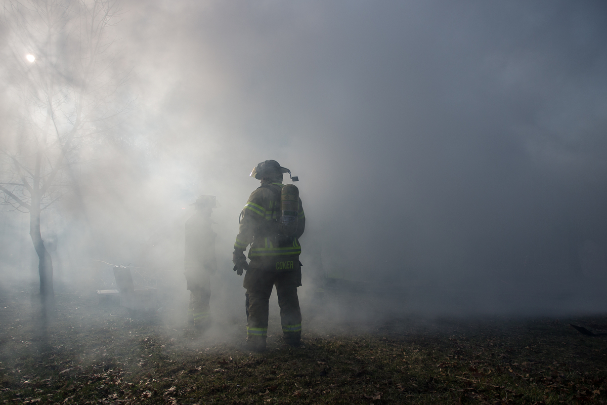 A fire fighter gets engulfed by smoke from a structure fire on Scully Road in Webster Township on Friday, March 10, 2017. The fire completely destroyed the home and a nearby field caught on fire. The cause of the fire is still under investigation. Matt Weigand | The Ann Arbor News
