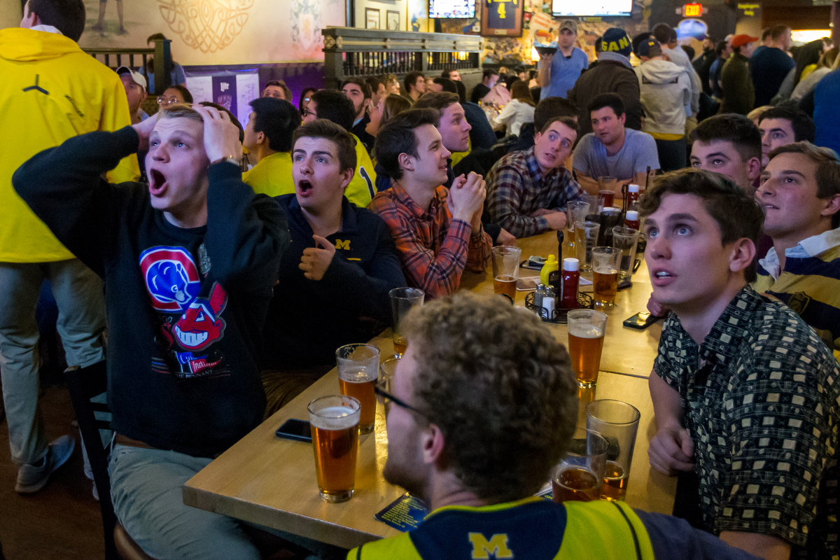 Michigan students and fans cheer as the Michigan and Oregon Sweet 16 game plays at the Blue Leprechaun on Thursday, March 23, 2017. The Michigan Wolverines lost to the Oregon Ducks 68-69. Matt Weigand | The Ann Arbor News