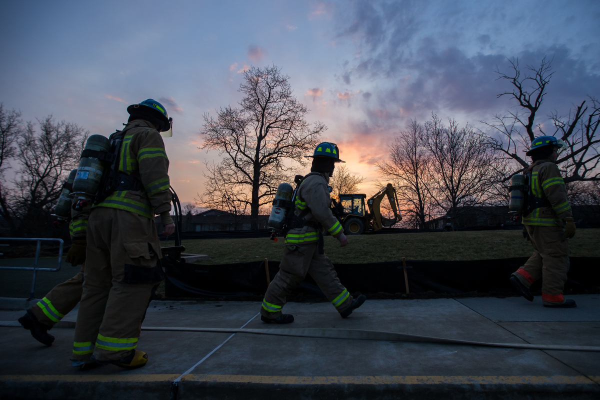Howell High School Firefighter cadets walk to a building for the beginning of a training exercise as part of the Howell High School Firefighter Academy program on Friday, March 24, 2017. The academy provides students with the proper training to take the state firefighter's exam. Matt Weigand | The Ann Arbor News