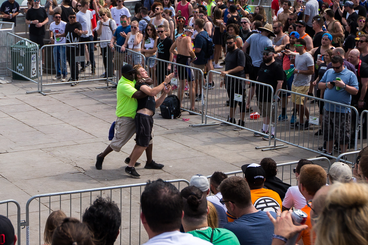 A man is tackled by a security guard after jumping over a gate at the Pyramid Stage at Hart Plaza in downtown Detroit for day two of Movement Electronic Music Festival on Sunday, May 28, 2017. Over 100 artists are scheduled to perform over the three-day Memorial Day festival. Matt Weigand   The Ann Arbor News