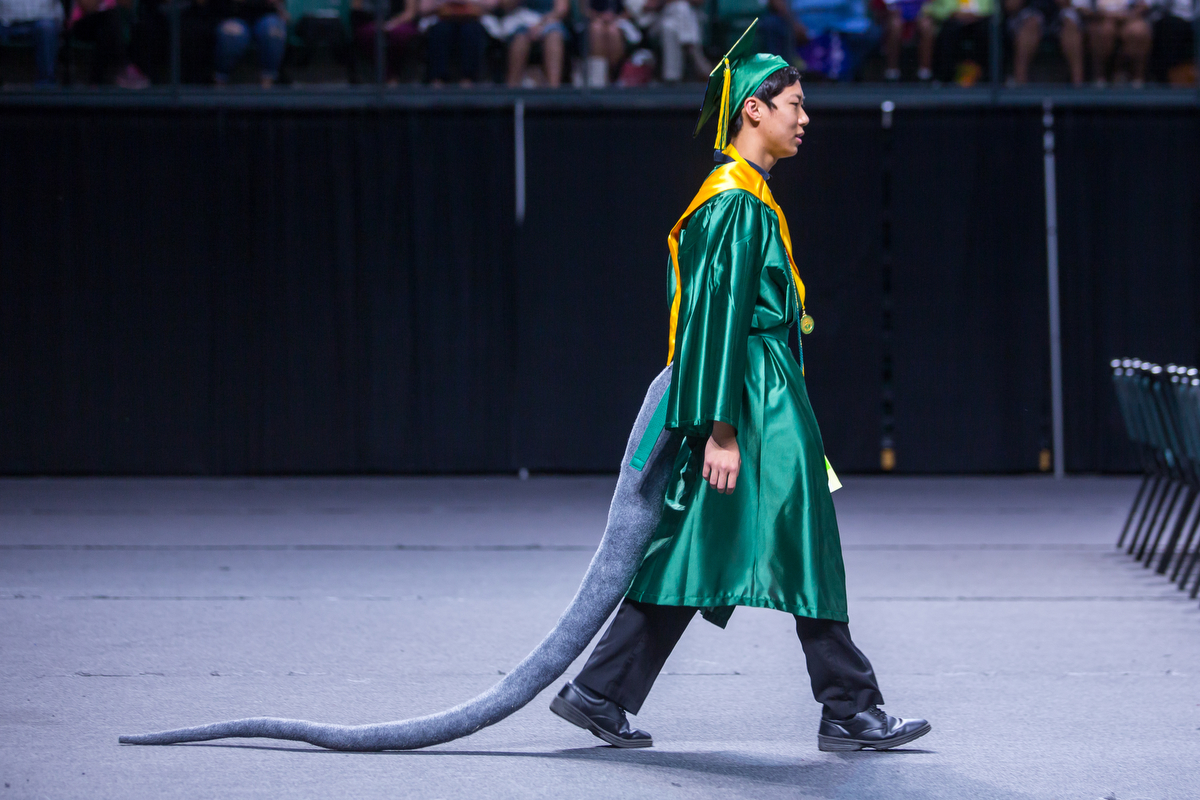 Huron High School student Richard Zhao wears a rat tail during his graduation at the Eastern Michigan University Convocation Center in Ypsilanti on Wednesday, June 7, 2017. 316 students accepted their diplomas and ended their high school careers. Matt Weigand | The Ann Arbor News