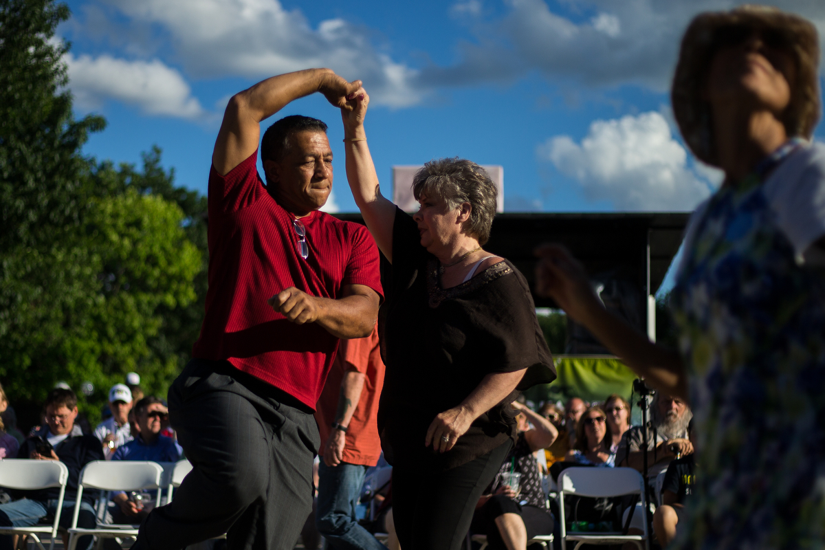 Two people dance while listening to Tumbao Bravo, a Latin jazz band, at Ingalls Mall during Top of the Park on Saturday, June 24, 2017. Matt Weigand | The Ann Arbor News
